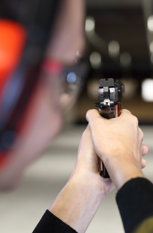 student at shooting range resilient security solutions